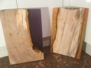 Resin boards created using a reusable container for resin pours