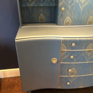 Beautility drinks cabinet with Peacock wallpaper