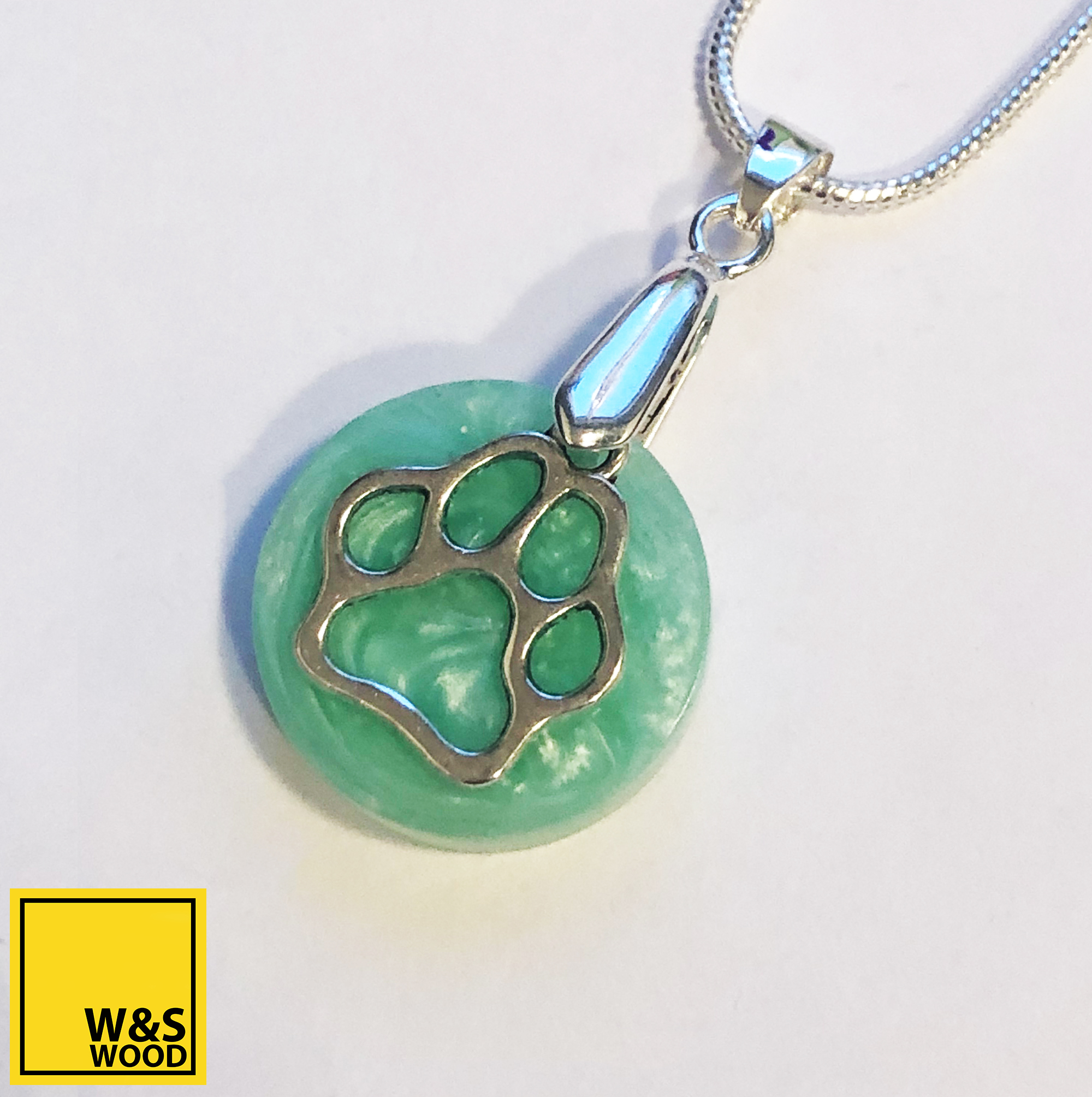 March round with paw print