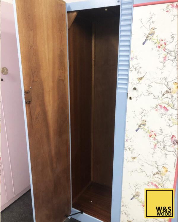 blue stag wardrobe with left door open