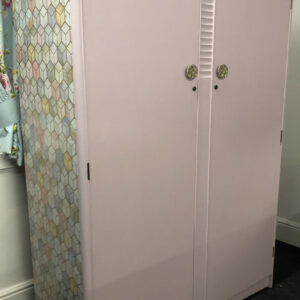 Stag pink painted wardrobe with geometric side panels