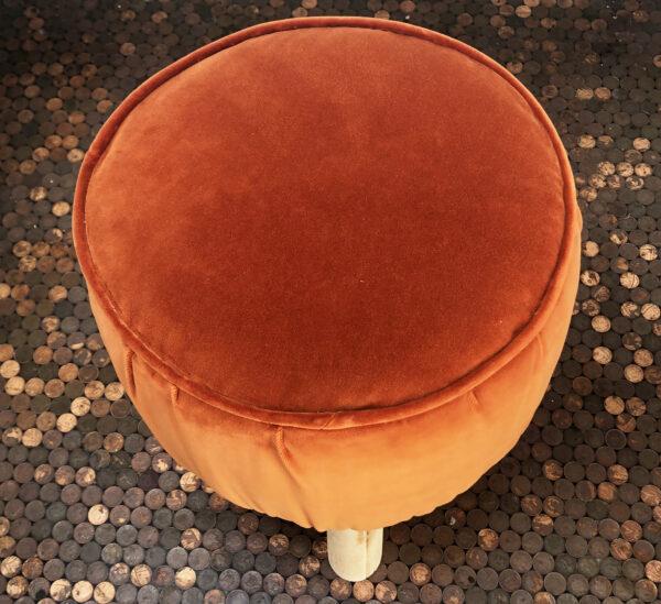 orange velvet stool top view