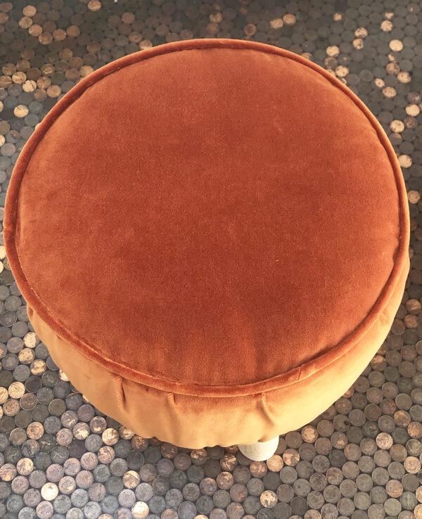 orange footstool top view